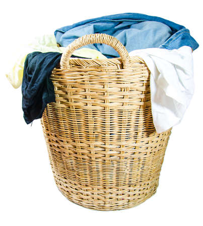 Wicker basket made  of green cloth on white background.