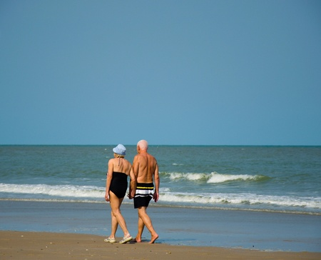 men women the two men walked together hand that beach at thai country Stock Photo - 18524339
