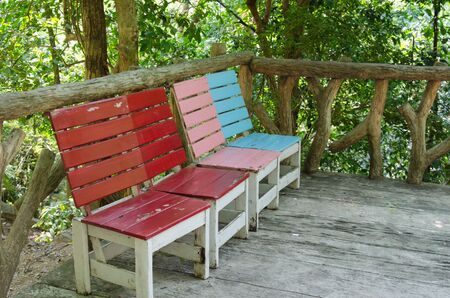 Chairs made ​​of wood put together a variety of colors. photo