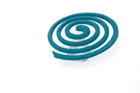 Mosquito repellent incense coil blue on white background photo