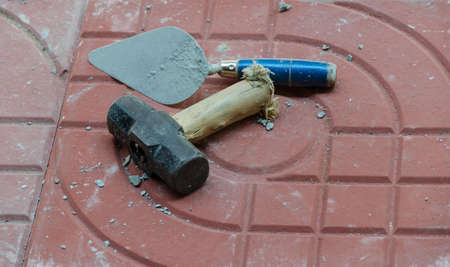 plastering: Hammer and plastering. On a white background. Stock Photo