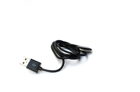 Phone charger is placed on a white background. Stock Photo