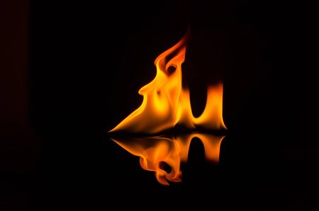 Flame isolated over black background photo