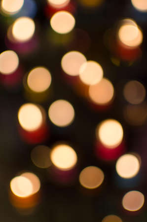 Beautiful bokeh caused by lighting candles together. photo