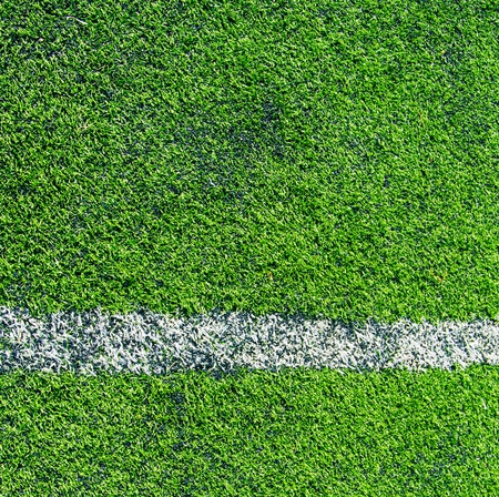 white lines in green grass field in the soccer field photo