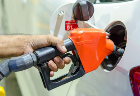 refilling the car with fuel on a filling station photo