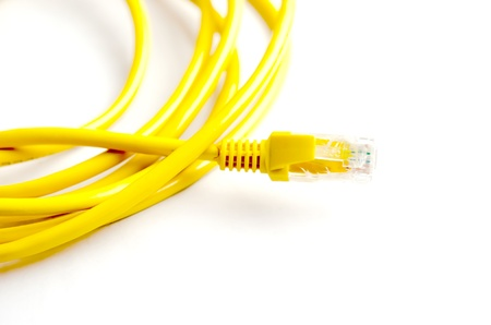Yellow cable. Computer on a white background. photo