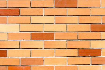 Orange brick wall, perfect as a background photo