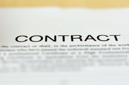 Detail of a contract document on table.
