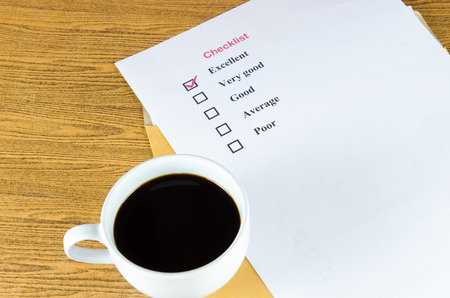 checklist coffee cup on the table. Stock Photo