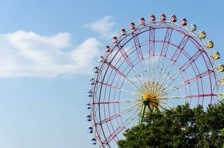 ferris wheel booths with blue sky in japan photo