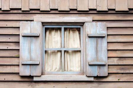 Classic wooden windows with walls made ​​of wood. photo