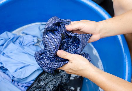 washing hand: The Washing clothes in the of blue bowl
