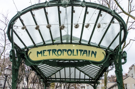 Metro Sign And Street Lamp In Paris photo