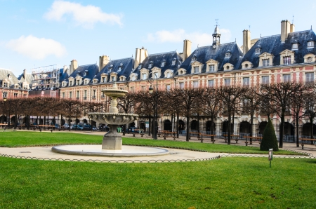 the place is outdoor: The Place des Vosges in Paris France. Stock Photo