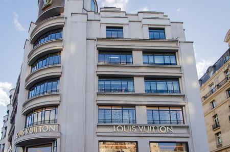 vuitton: PARIS - DEC 26: Louis Vuitton store on the Champs-Elysees in Paris, France on December 26, 2013