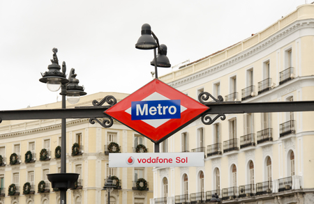 Metro Sign And Street Lamp In Madrid