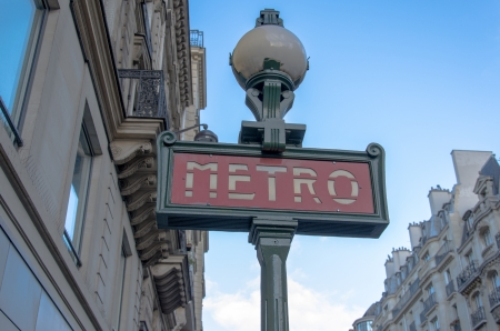Metro Sign And Street Lamp In Paris
