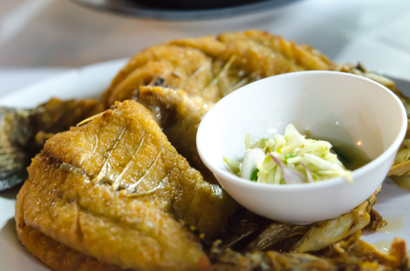 Fried fish with Fish Sauce on a plate. Stock Photo - 25186272