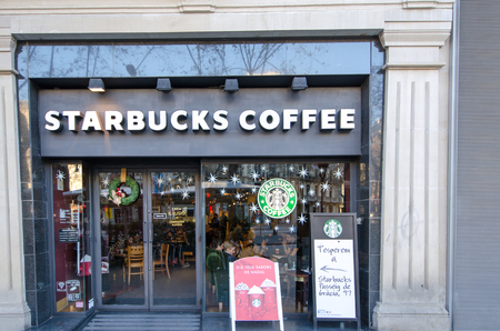 BARCELONA , SPAIN - DEC 29: A retail outlet for Starbucks on Dec 29, 2013 in Barcelona, Spain. Starbucks has 19,972 stores in 60 countries. Editorial