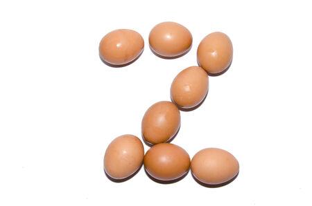 fonte para os ovos dispostos juntos. Isolated background Banco de Imagens