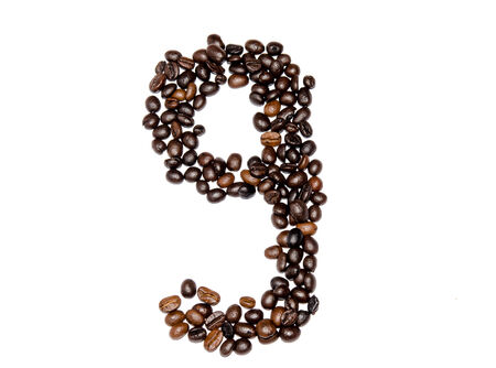 Numbers made from coffee beans isolated on white background. photo
