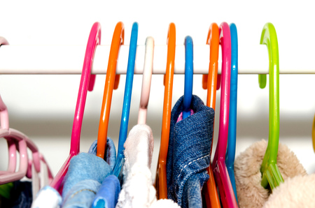 clothing rack: Clothes Hanger hanging in the wardrobe of many colors