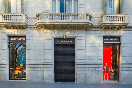 vuitton: BARCELONA, SPAIN - DEC 29: Louis Vuitton store on the  street Passeig de Gracia in Barcelona. A shopping district. December 29, 2013. Editorial