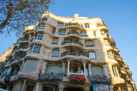 BARCELONA, SPAIN - DEC 29: Casa Mila is a building block with tourists and one in Barcelona. designed by Antoni Gaudi December 29, 2013