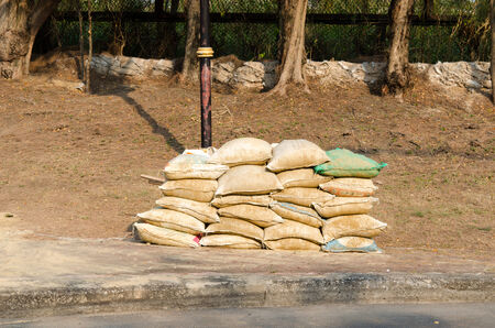 The sandbag are stacked on the floor. photo