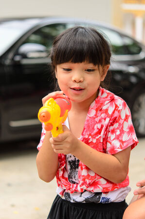 Asian women playing Songkran water gun. photo