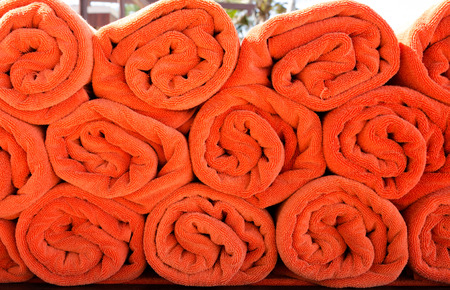 Orange towel roll placed together. Stock Photo