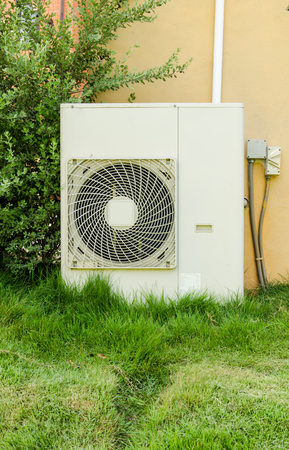 air conditioners installation outside on the lawn