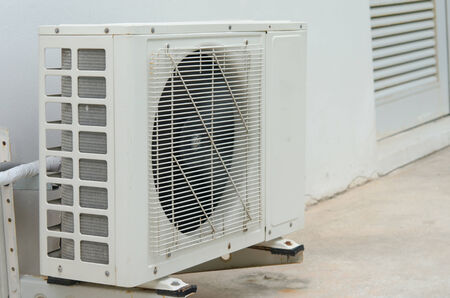 air conditioners installation outside on the floor photo