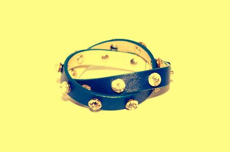 Leather bracelets isolated on the background. vintage photo