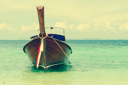 long tailed boat: Long tailed boat at Phi-phi island in Thailand. Vintage
