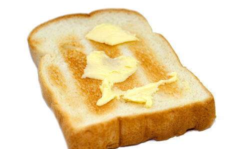 buttered: Buttered toast isolated on the white background.
