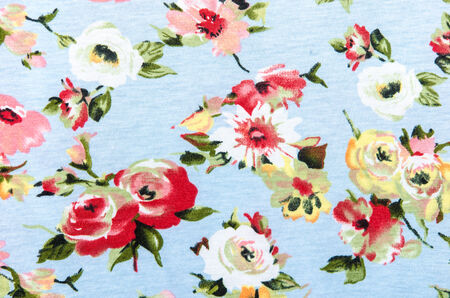 Flowers design seamless pattern on fabric background photo