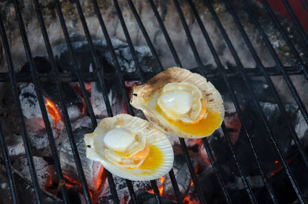 scallops: Grilled scallops topped with butter