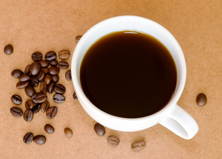 Coffee and coffee beans on wooden background. photo