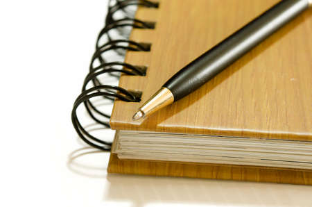 notebook with pen on a white background photo
