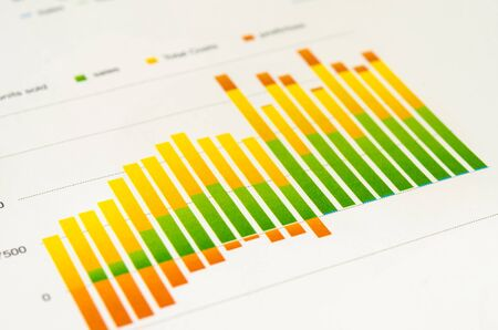 analyzing investment charts on table. Stock Photo