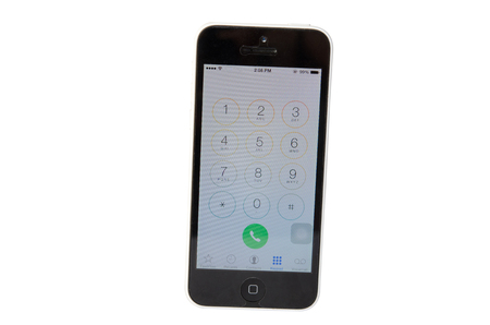 handoff: SAMUT PRAKAN, THAILAND - December 28, 2014: IPHONE 5C white on the dial number application for call