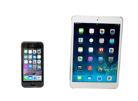 SAMUT PRAKAN, THAILAND - JANUARY 14, 2015:New Ipad air 2 and  iPhone 5c with colorful screen. iPhone and ipad was created and developed by the Apple inc. Editorial