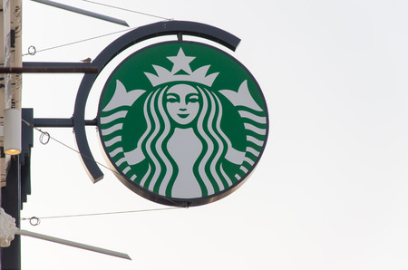 famous industries: BANGPRAKONG, THAILAND - MARCH 30 2015: Starbucks logo on Jun 14 in Motorway Rest Area. It is an US global coffee company, the largest coffeehouse company in the world, with 23,187 stores in 64 countries.
