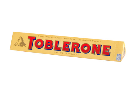toblerone: BANGKOK,THAILAND - April 01, 2015: Studio shot of Swiss chocolate bar Toblerone isolated on white background. Editorial