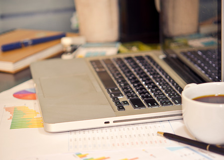 cluttered: Desk cluttered with business documents.vintage effect style pictures
