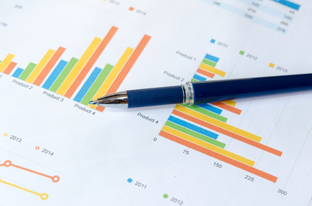 financial graph: Financial graphs analysis and pen.