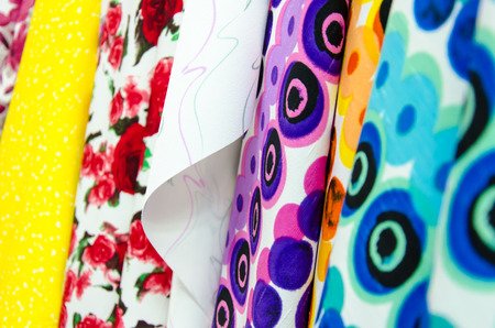 Closeup of various fabric bolts in store Stock Photo