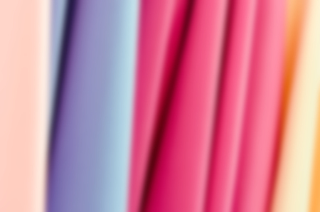 Closeup of various fabric bolts in store.blur background.